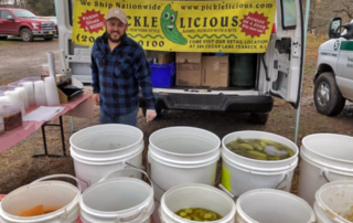 Pickle vendor at Hunterdon Land Trust Winter Farmers' Market in Flemington, NJ